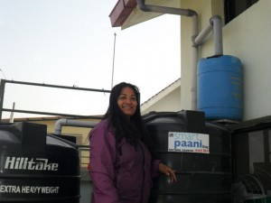 Shriju Pradhan with one of their SmartPaani Rainwater Harvesting Systems